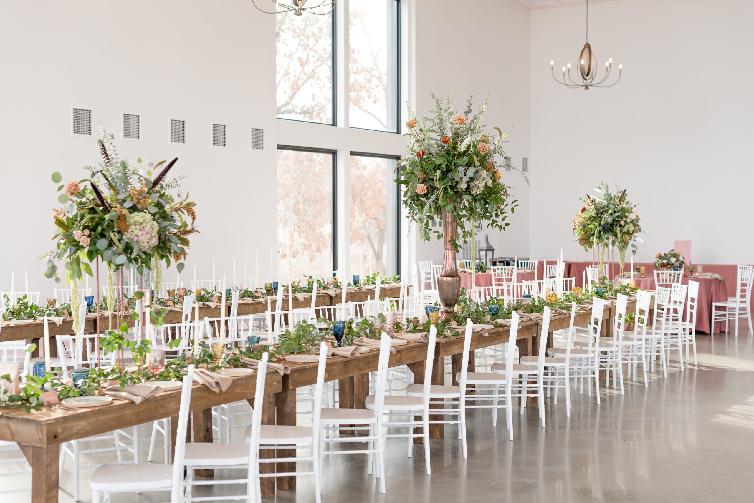 table with wedding florals at wedding at Osage House